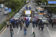 Pro-democracy supporters march along a road during a demonstration in Bangkok, Thailand, Thursday, June 24, 2021. Pro-democracy demonstrators have taken to the streets of Thailand's capital again, marking the 89th anniversary of the overthrow of the country's absolute monarchy by renewing their demands that the government step down, the constitution be amended and the monarchy become more accountable. (AP Photo/Wason Wanichakorn)