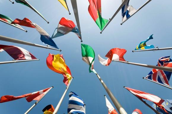Flags from multiple nations waving overhead