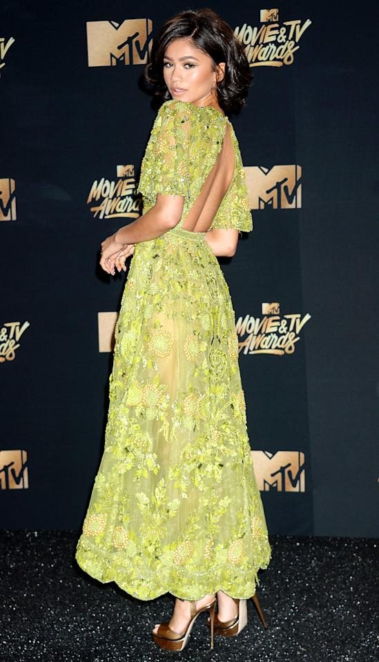 <p>makes us green with envy in her plunging, sheer, floral-embroidered Zuhair Murad dress teamed with metallic Le Silla sandals and glowy makeup.</p>
