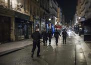 Police patrol in the streets as the curfew starts in Paris, Saturday, Oct. 17, 2020. French restaurants, cinemas and theaters are trying to figure out how to survive a new curfew aimed at stemming the flow of record new coronavirus infections. The monthlong curfew came into effect Friday at midnight, and France is deploying 12,000 extra police to enforce it. (AP Photo/Lewis Joly)