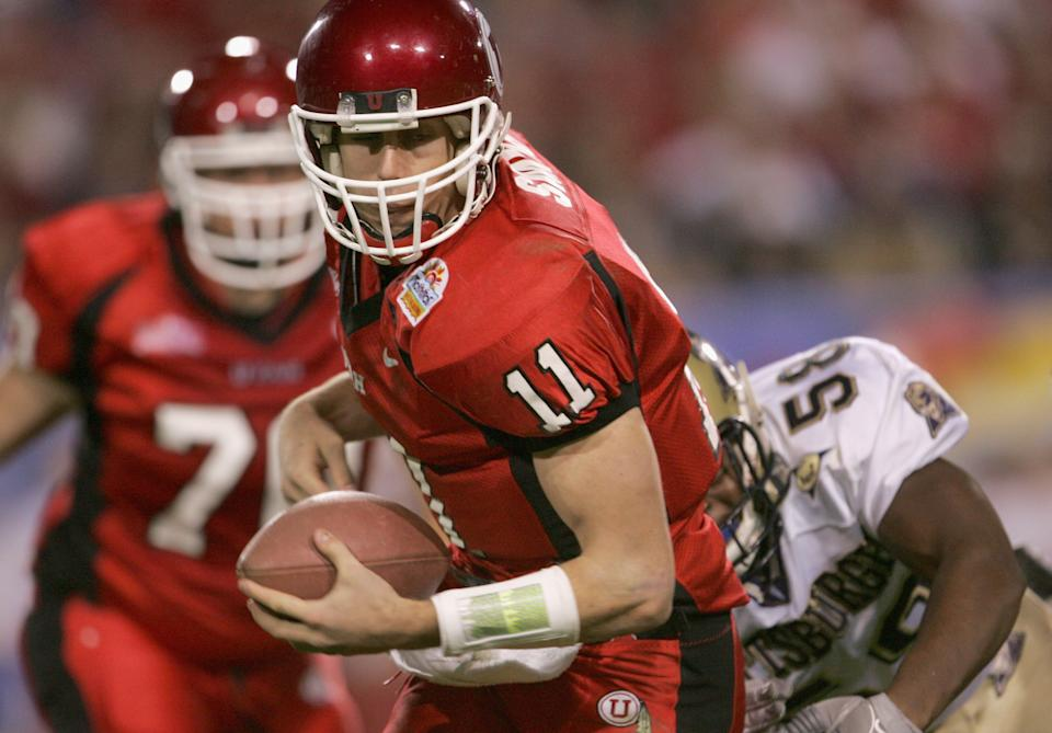 Alex Smith of Utah gets away from Joe Clermond of Pittsburgh in the second quarter of the Tostito's Fiesta Bowl on Jan. 1, 2005. (Jeff Gross/Getty Images)
