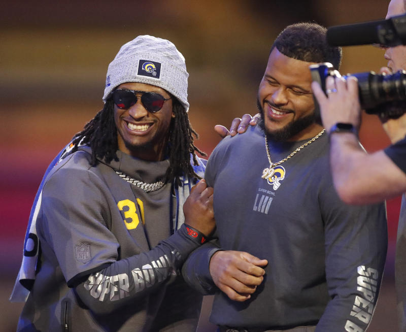 The Los Angeles Rams placed two players in the top 10 of NFL Network's Top 100 list: Aaron Donald, right, and Todd Gurley. (AP)