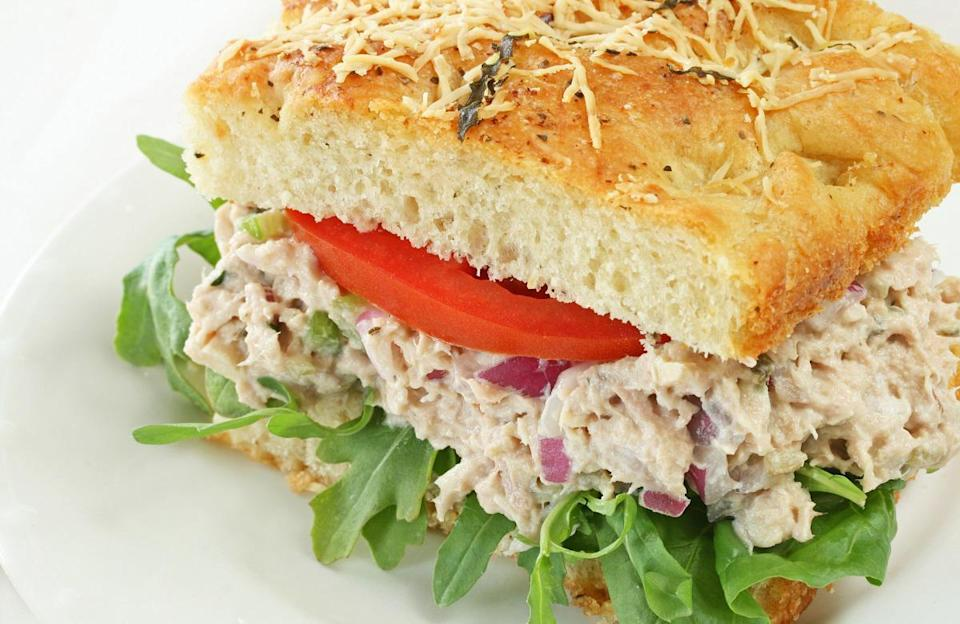 """<p>Tuna salad is perfect for <a href=""""https://www.thedailymeal.com/meal-prep-hacks-to-save-you-time?referrer=yahoo&category=beauty_food&include_utm=1&utm_medium=referral&utm_source=yahoo&utm_campaign=feed"""" rel=""""nofollow noopener"""" target=""""_blank"""" data-ylk=""""slk:active meal preppers"""" class=""""link rapid-noclick-resp"""">active meal preppers</a> — it can last in the fridge for up to five days. This rendition that uses Greek yogurt and avocado is a go-to for people who have an aversion to mayonnaise.</p> <p><a href=""""https://www.thedailymeal.com/healthy-tuna-salad-recipe?referrer=yahoo&category=beauty_food&include_utm=1&utm_medium=referral&utm_source=yahoo&utm_campaign=feed"""" rel=""""nofollow noopener"""" target=""""_blank"""" data-ylk=""""slk:For the Healthy Tuna Salad Sandwich recipe, click here."""" class=""""link rapid-noclick-resp"""">For the Healthy Tuna Salad Sandwich recipe, click here.</a></p>"""