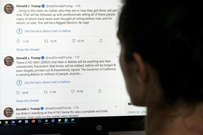 """Under two tweets by the president, Twitter posted a link reading """"Get the facts about mail-in ballots"""""""