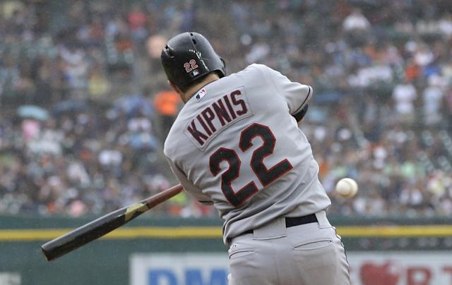 Cleveland Indians' Jason Kipnis connects for an RBI single during the fifth inning in the first baseball game of a doubleheader against the Cleveland Indians, Saturday, July 19, 2014, in Detroit. (AP Photo/Carlos Osorio)