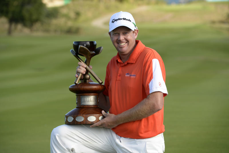 Steve Jeffress of Australia poses with the winner''s trophy on the final day of the Fiji International golf tournament, at the Natadola Bay Championship golf course in Nadi, on August 17, 2014