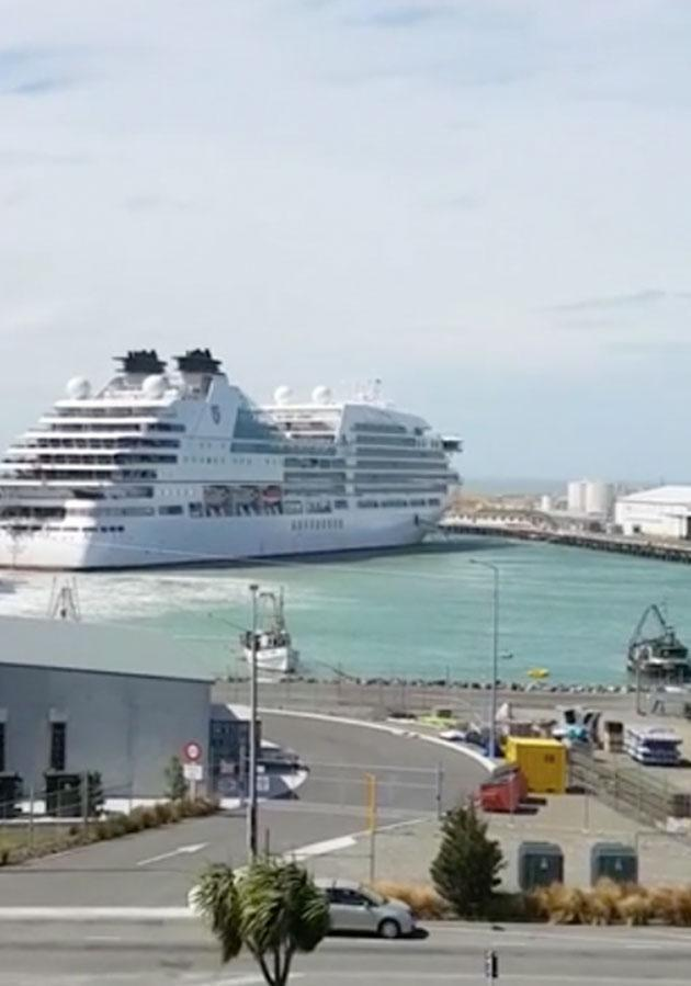 The footage ends with the cruise liner still only partially moored. Source: Facebook/Storyful