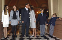 """FILE - In this file photo taken Nov. 17, 2003, Arnold Schwarzenegger kisses his wife Maria Shriver just before taking the oath of office as California's 38th governor on the steps of the Capitol in Sacramento, Calif. Also seen are the Schwarzenegger children, from left, Katherine, Christina, Patrick and Christopher. In an interview with """"60 minutes"""" that is scheduled to air Sunday, Schwarzenegger says the affair he had with longtime housekeeper Mildred Baena, that led to a son, was """"the stupidest thing"""", he ever did to then-wife Maria Shriver.(AP Photo/Rich Pedroncelli, file)"""