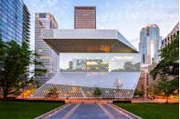 """<p>There aren't many libraries that will stop you in your tracks — but Seattle's unusual 11-story glass and steel <a href=""""https://www.spl.org"""" rel=""""nofollow noopener"""" target=""""_blank"""" data-ylk=""""slk:structure"""" class=""""link rapid-noclick-resp"""">structure</a> is one of them. There's a lot that makes this building unique, including its """"book spiral,"""" a winding array of shelves connected by ramps that allow visitors to browse the bookshelves without ever heading to another floor. <br></p>"""