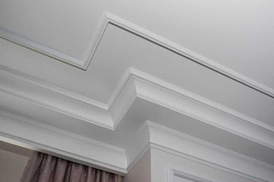 "Crown molding can add some <a href=""https://bestlifeonline.com/dated-home-design/?utm_source=yahoo-news&utm_medium=feed&utm_campaign=yahoo-feed"" rel=""nofollow noopener"" target=""_blank"" data-ylk=""slk:old-fashioned"" class=""link rapid-noclick-resp"">old-fashioned</a> style to any home, but if those pieces don't line up seamlessly, you could have serious—and potentially-costly—issues to contend with. Uneven moldings can be an indication of foundation issues or may signal that you have water damage behind your walls, causing the molding to become soft and droop."