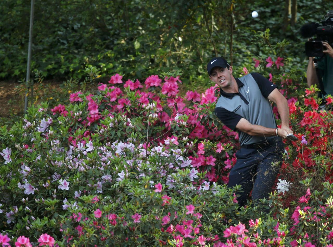 Northern Ireland's Rory McIlroy hits from the azaleas on the 13th hole during the second round of the Masters golf tournament at the Augusta National Golf Club in Augusta, Georgia April 11, 2014. REUTERS/Mike Blake (UNITED STATES - Tags: SPORT GOLF)