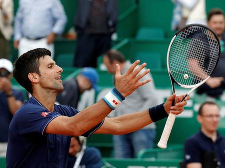 Tennis - Monte Carlo Masters - Monaco, 18/04/2017. Novak Djokovic of Serbia reacts after defeating Gilles Simon of France.     REUTERS/Eric Gaillard
