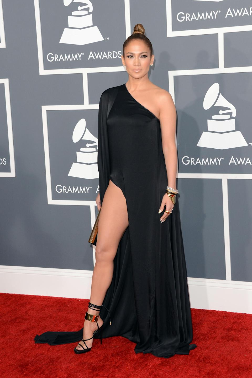 <p>Going for a more demure look at the 55th Annual Grammy Awards, this leggy ensemble showed that J.Lo, like always, still has it. The asymetric look was a fresh take for the 'Live it Up' performer. [Photo: Getty] </p>