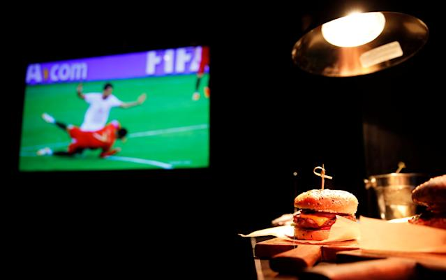 A burger is seen before being delivered to guests during the Group B match Portugal vs Spain at a restaurant in central Moscow, Russia, June 15, 2018. As well as shooting all the matches, Reuters photographers are producing pictures showing their own quirky view from the sidelines of the World Cup. REUTERS/Christian Hartmann