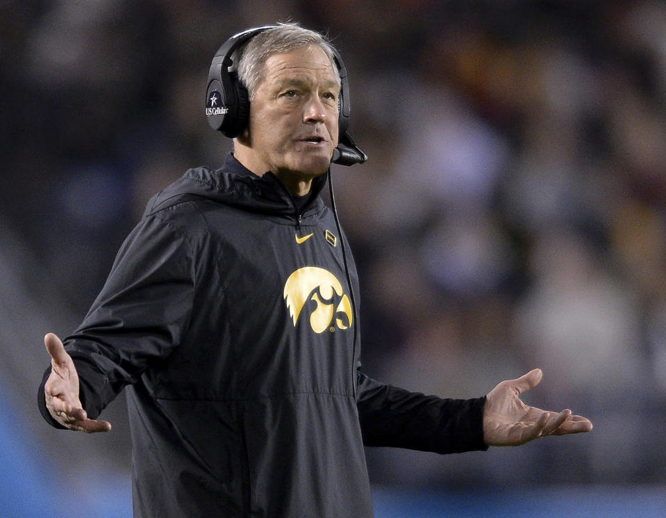 FILE - In this Dec. 27, 2019, file photo, Iowa head coach Kirk Ferentz reacts during the second half of the Holiday Bowl NCAA college football game against Southern California. The University of Iowa said it would not pay a demand from eight Black former football players for $20 million in compensation for alleged racial discrimination they faced while they played for the Hawkeyes. The players also called for the firings of Kirk Ferentz, offensive line coach Brian Ferentz and athletic director Gary Barta. (AP Photo/Orlando Ramirez, File)