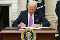 US President Joe Biden signs executive orders as part of his Covid-19 response at the White House on January 21, 2021