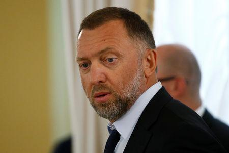 FILE PHOTO: Oleg Deripaska, president of Russian aluminum giant Rusal, looks on before a meeting of Russian President Vladimir Putin and Turkish President Tayyip Erdogan with Russian and Turkish entrepreneurs at the Konstantinovsky Palace in St. Petersburg, Russia, August 9, 2016.  REUTERS/Sergei Karpukhi/File Photo