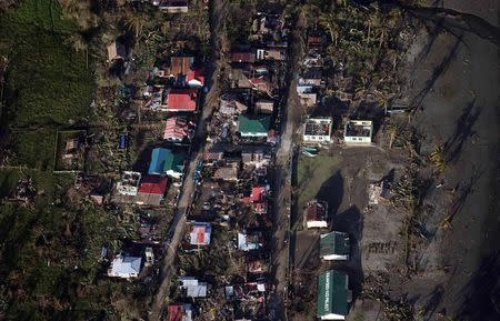 An aerial view shows damaged houses after strong winds and heavy rains brought on by Typhoon Hagupit battered Can-Avid municipality, Eastern Samar, central Philippines, in this December 9, 2014 handout picture courtesy of Philippine Air Force. REUTERS/Philippine Air Force/Handout via Reuters