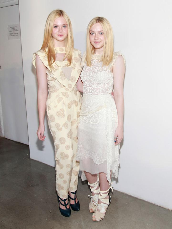 "Sisters (and ""Village of the Damned"" replicas) Elle and Dakota Fanning delivered double trouble upon arriving at the Rodarte Spring 2012 show during New York Fashion Week. Thirteen-year-old Elle -- who recently starred in ""Super 8"" -- sported a cream-colored catastrophe, while 17-year-old Dakota donned an equally absurd dress and mummy-like heels that completely washed her out. Charles Eshelman/<a href=""http://www.gettyimages.com/"" target=""new"">GettyImages.com</a> - September 13, 2011"