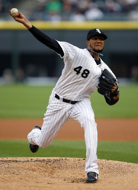 Chicago White Sox starting pitcher Hector Noesi delivers against the Detroit Tigers during the first inning of a baseball game on Monday, June 9, 2014, in Chicago. (AP Photo/Jeff Haynes)