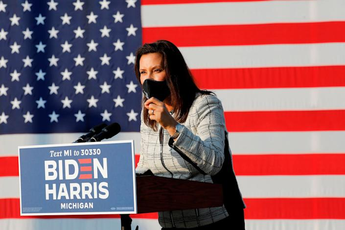 Michigan Gov. Gretchen Whitmer introduces Democratic vice presidential nominee Sen. Kamala Harris in Detroit in September. A militia was plotting to kidnap Whitmer, according to the FBI. (Photo: JEFF KOWALSKY via Getty Images)
