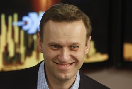 Russian opposition leader Alexei Navalny smiles in the studio of the radio station Echo of Moscow in Moscow, Russia December 27, 2017. REUTERS/Sergei Karpukhin