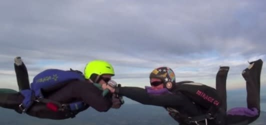 Taking the plunge: Brave boyfriend proposes at 10,000ft during skydive
