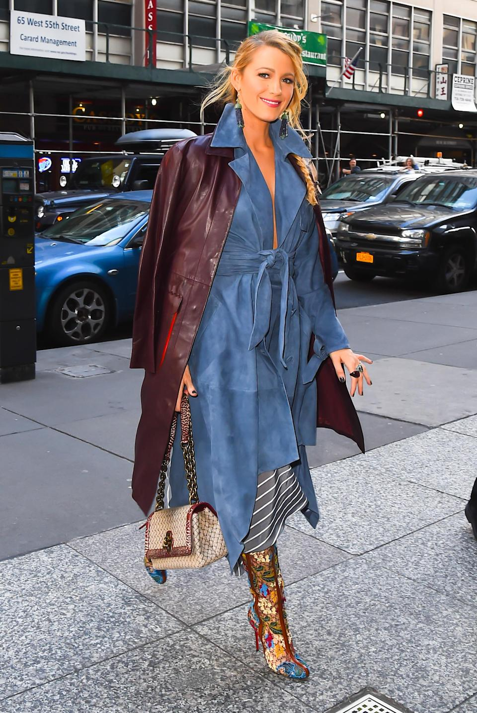 <p>It was all about the styling for her late-afternnon look. Lively paired a suede trench dress from Jonathan Simkhai with a maroon Bottega Veneta leather coat. But she didn't stop there — her floral boots really took things to the next level. (Photo: Getty Images) </p>