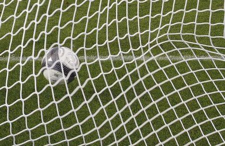 A soccer ball is seen in a net during the French Ligue 1 soccer match between Girondins Bordeaux and Racing Lens at the Chaban Delmas stadium in Bordeaux on August 9, 2009. REUTERS/Regis Duvignau