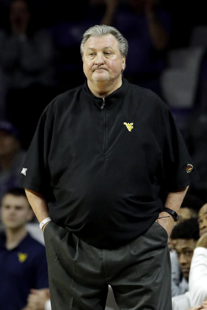 West Virginia head coach Bob Huggins watches during the first half of an NCAA college basketball game against Kansas State Saturday, Jan. 18, 2020, in Lawrence, Kan. (AP Photo/Charlie Riedel)