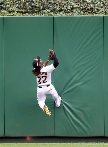 Pittsburgh Pirates center fielder Andrew McCutchen kicks off the wall as he looks for a fly ball by Chicago Cubs' Josh Vitters that went for a home run in the fourth inning of a baseball game on Sunday, Sept. 9, 2012, in Pittsburgh. (AP Photo/Keith Srakocic)