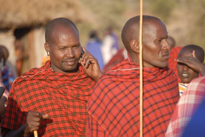 """<span class=""""caption"""">A Maasai man receives a call on his mobile phone.</span> <span class=""""attribution""""><span class=""""source"""">Timothy D. Baird/Virginia Tech</span>, <a class=""""link rapid-noclick-resp"""" href=""""http://creativecommons.org/licenses/by-nd/4.0/"""" rel=""""nofollow noopener"""" target=""""_blank"""" data-ylk=""""slk:CC BY-ND"""">CC BY-ND</a></span>"""