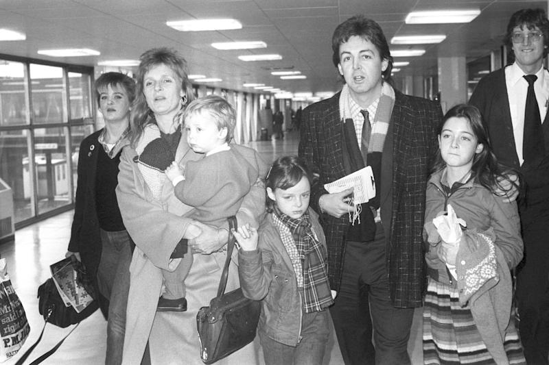 Former Beatles star Paul McCartney with his wife Linda and members of their family, Heather (left), 17, James, 2, Stella (centre), 8, and Mary, 10, at Heathrow Airport in London as they left for New York on Concorde. (Photo by PA Images via Getty Images)