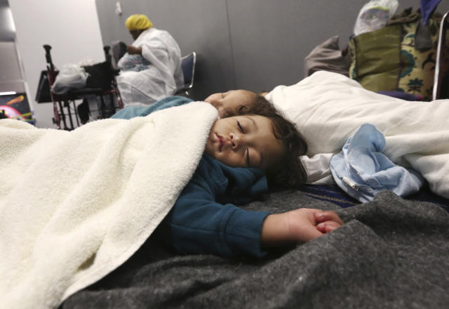 <p>Robert Salgado, 2, sleeps on the floor at the George R. Brown Convention Center that has been set up as a shelter for evacuees escaping the floodwaters from Tropical Storm Harvey in Houston, Texas, Tuesday, Aug. 29, 2017. (Photo: LM Otero/AP) </p>