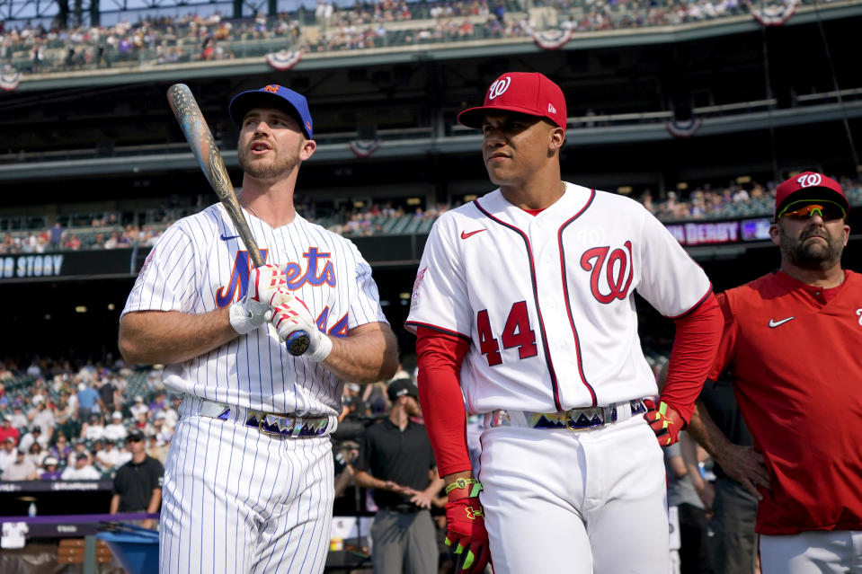 National League's Juan Soto, of the Washington Nationals, and National League's Pete Alonso, of the New York Mets, watch during batting practice for the MLB All-Star baseball game, Monday, July 12, 2021, in Denver. (AP Photo/Gabriel Christus)