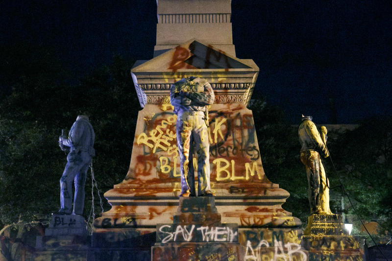 Protesters beheaded and then pulled down four statues that were part of a Confederate monument. Source: The Virginian-Pilot via AP)