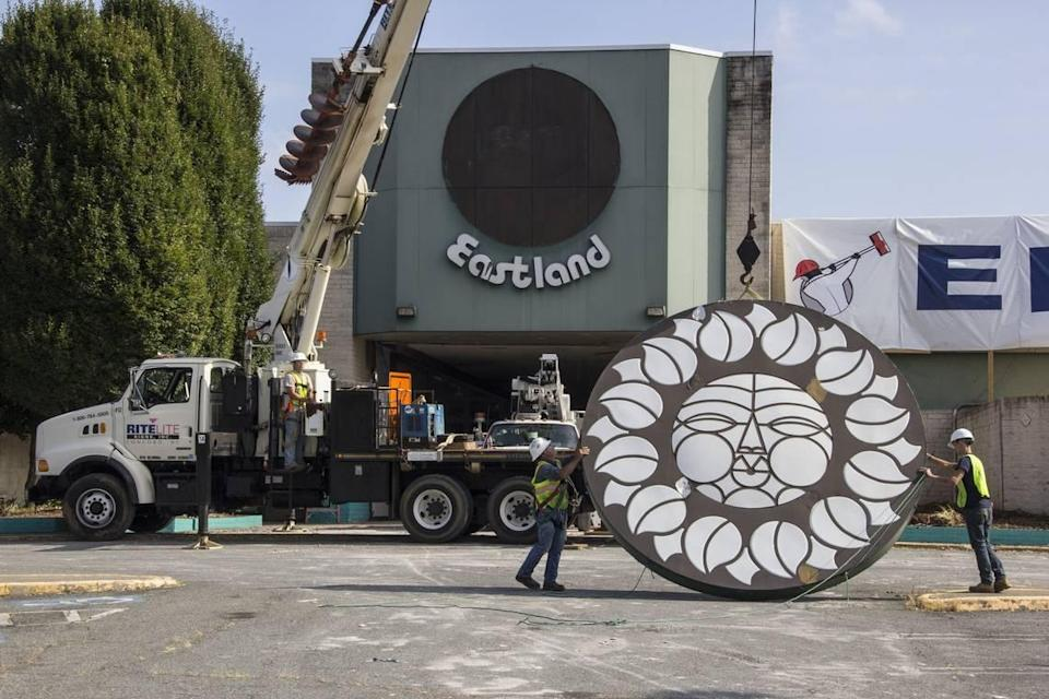 """The final """"Rising Sun"""" signage at Eastland Mall being removed and prepared for transport to a storage facility in Concord as it awaits future installation as public art."""