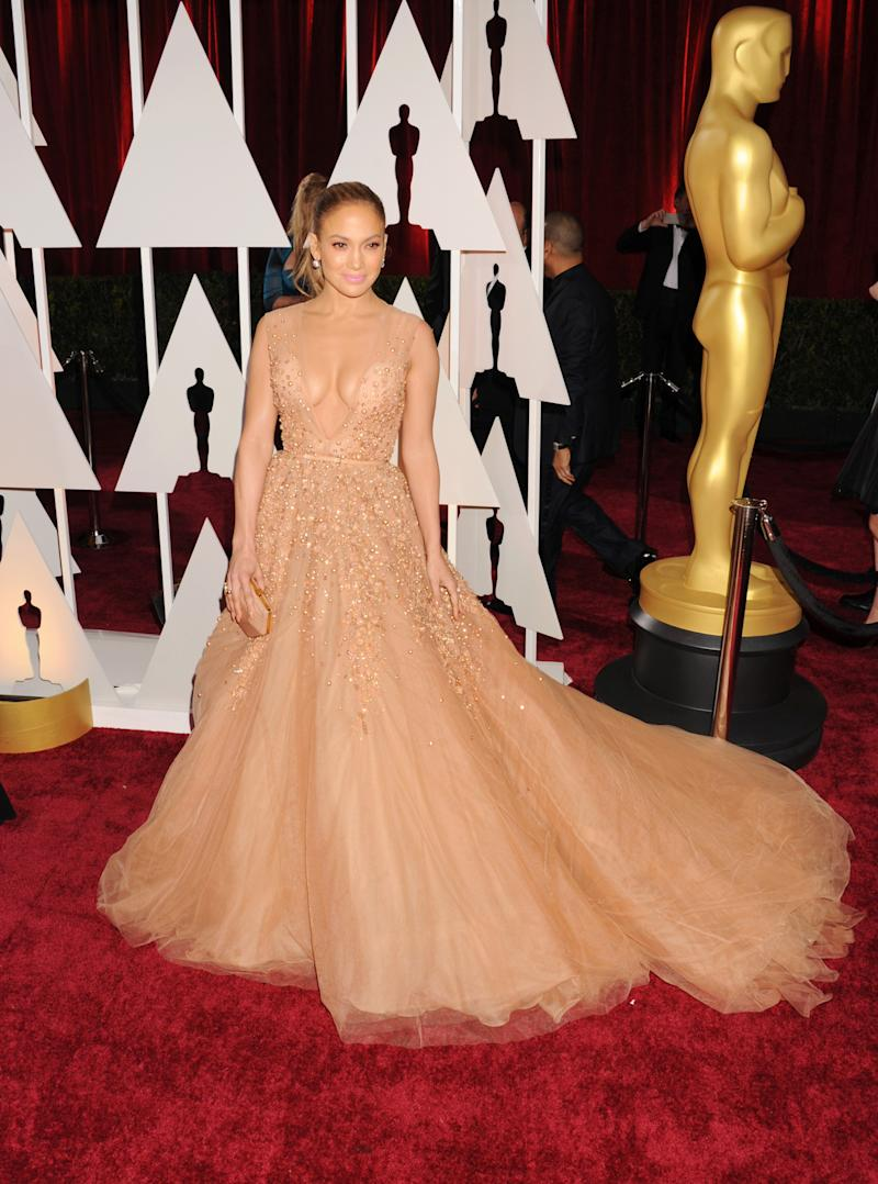 At first glance, this gown is classic Elie Saab: very, very pretty, but unsurprising. It's only on closer look that you realize the sheer illusion disguising a plunging neck. Jennifer Lopez in Elie Saab at the 87th annual Academy Awards in Hollywood, California, February 2015. Photo by Jeffrey Mayer/WireImage.