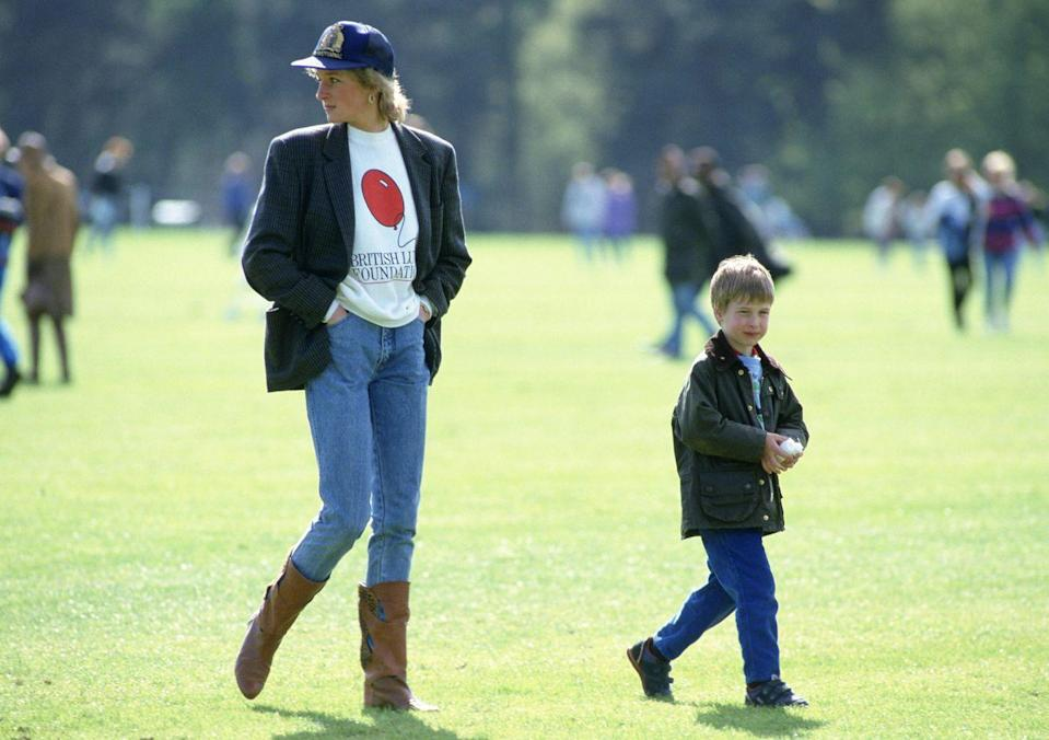 """<p>This famous 1988 image of Princess Diana and young Prince William never gets old. Diana, chic as ever, tucked her high-waisted jeans into some knee-high boots, and wore an oversized blazer over a British Lung Foundation sweatshirt. She wore a cap on top of her feathered locks and...sigh...it's perfection in an outfit. Hailey Baldwin even recreated this look for a Vogue <a href=""""https://www.cosmopolitan.com/uk/fashion/celebrity/a28865385/hailey-baldwin-princess-diana-photoshoot/"""" rel=""""nofollow noopener"""" target=""""_blank"""" data-ylk=""""slk:photoshoot"""" class=""""link rapid-noclick-resp"""">photoshoot</a>.</p>"""