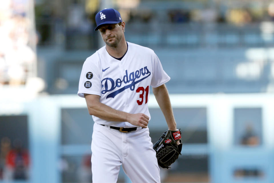 Los Angeles Dodgers starting pitcher Max Scherzer reacts after striking out Houston Astros' Aledmys Diaz during the first inning of a baseball game in Los Angeles, Wednesday, Aug. 4, 2021. (AP Photo/Alex Gallardo)