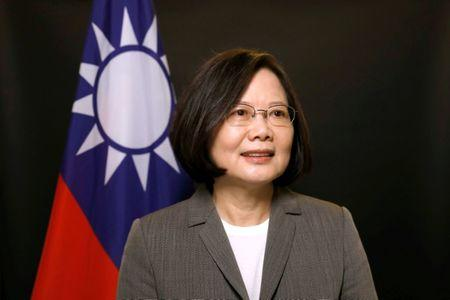 FILE PHOTO: Taiwan President Tsai Ing-wen poses for photographs during an interview with Reuters at the Presidential Office in Taipei, Taiwan