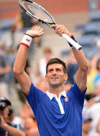 Aug 31, 2015; New York, NY, USA; Novak Djokovic of Serbia celebrates after beating Joao Souza of Brazil 6-1, 6-1, 6-1 on day one of the 2015 US Open at USTA Billie Jean King National Tennis Center. Mandatory Credit: Robert Deutsch-USA TODAY Sports