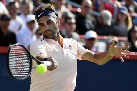 Aug 12, 2017; Montreal, Quebec, Canada; Roger Federer of Switzerland hits a forehand against Robin Haase of the Netherlands (not pictured) during the Rogers Cup tennis tournament at Uniprix Stadium. Mandatory Credit: Eric Bolte-USA TODAY Sports