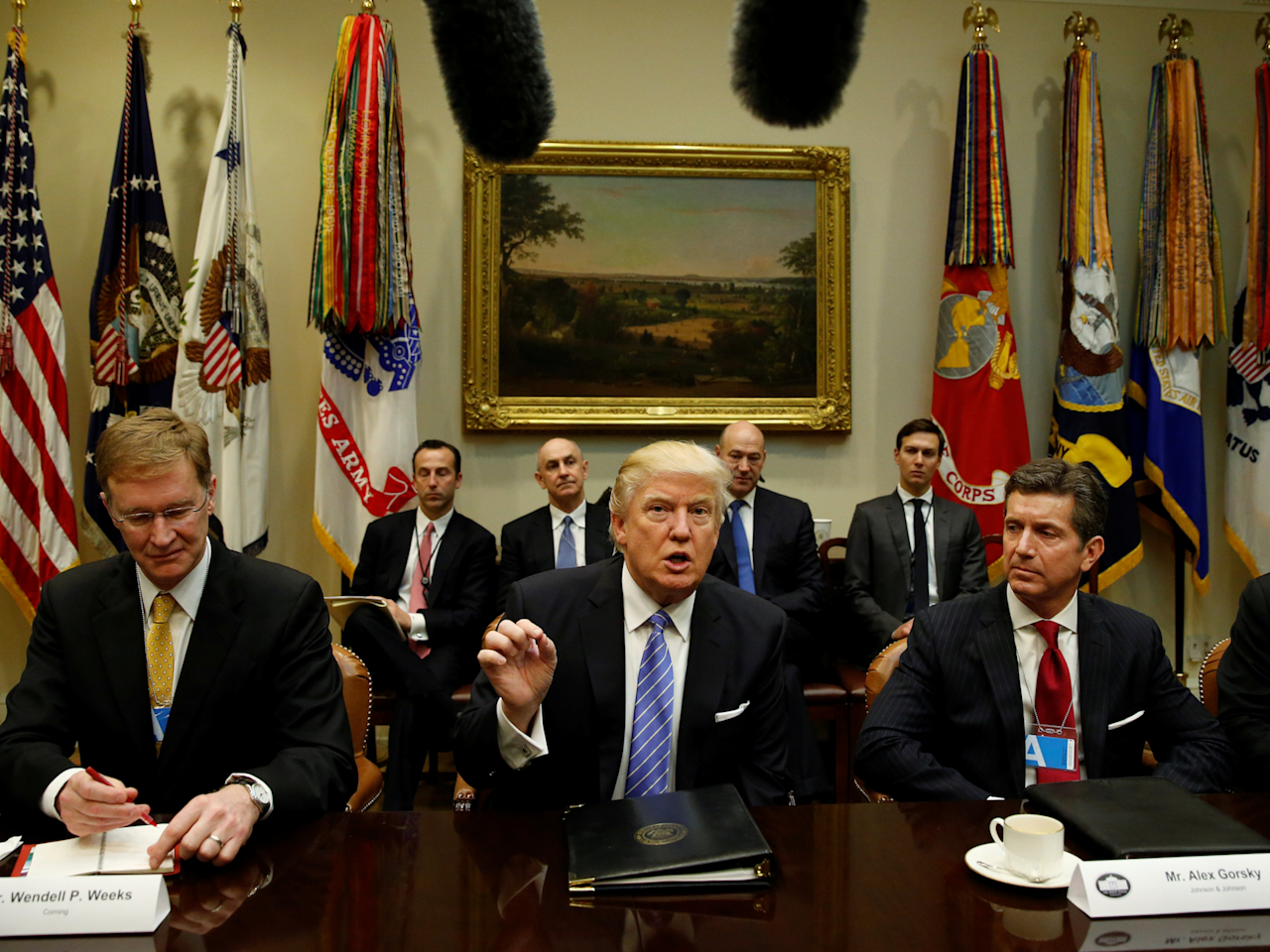 U.S. President Donald Trump hosts a meeting with business leaders in the Roosevelt Room of the White House in Washington January 23, 2017. From left are Corning CEO Wendell Weeks, Trump, Johnson & Johnson CEO Alex Gorsky and Dell CEO Michael Dell.