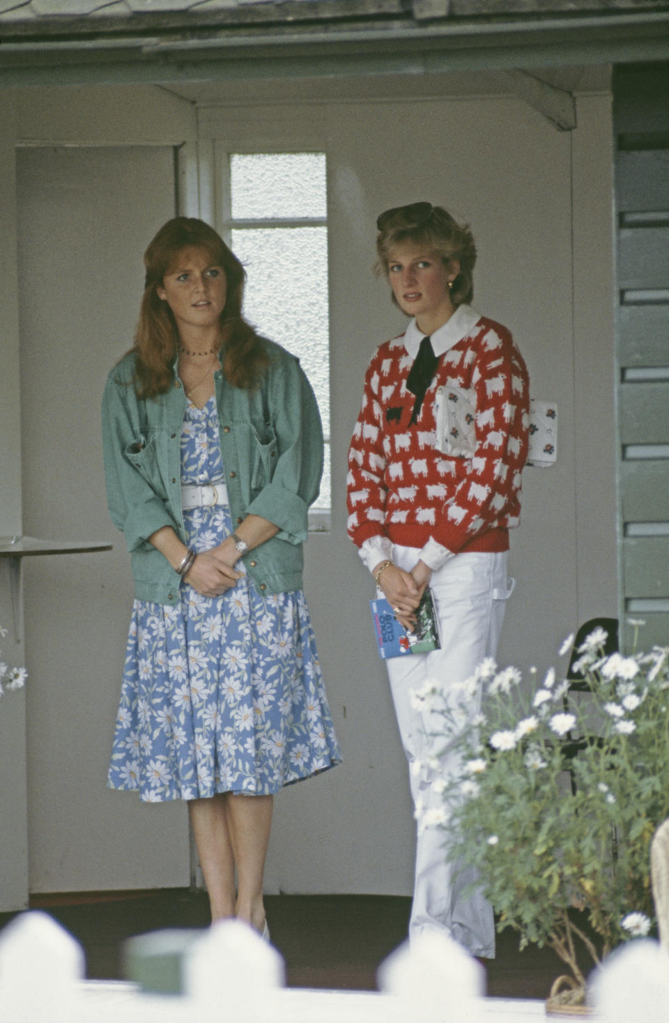 Diana, Princess of Wales  (1961 - 1997) with her friend Sarah Ferguson at a polo match at Smith's Lawn, Guards Polo Club, Windsor, June 1983. Diana is wearing a Muir and Osborne 'black sheep' sweater. (Photo by Princess Diana Archive/Getty Images)