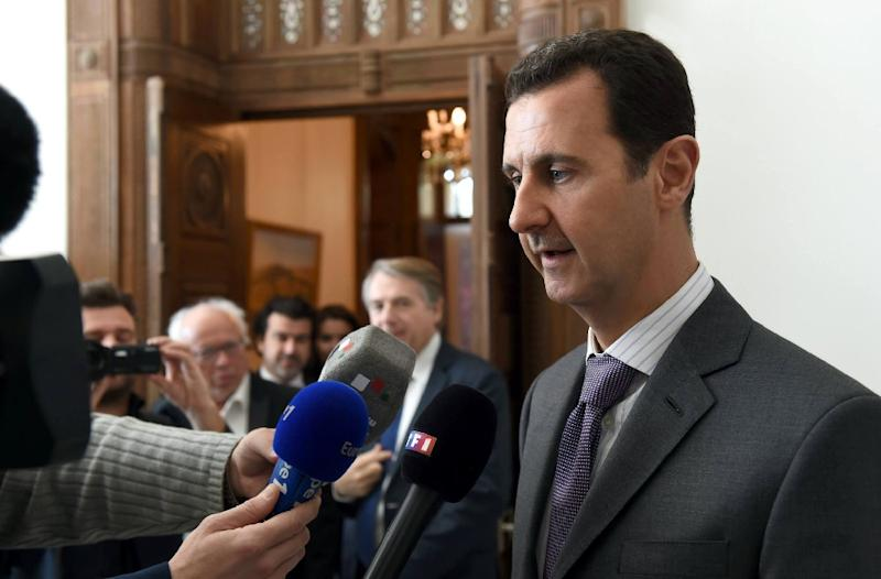 An image obtained from the official facebook page of Syrian Presidency shows Syrian President Bashar al-Assad speaking to the press following a meeting in Damascus on November 14, 2015