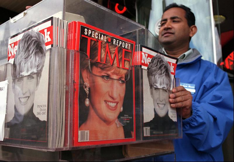 FILE - In this Thursday, Sept. 4, 1997, file photo, Cashier Mizan Rahman makes change for a customer from behind a display of the latest news weeklies at the Out of Town News stand in Harvard Square in Cambridge, Mass. Newsweek announced Thursday, Oct. 18, 2012 that it will end its print publication after 80 years and shift to an all-digital format in early 2013. Its last U.S. print edition will be its Dec. 31 issue. The paper version of Newsweek is the latest casualty of a changing world where readers get more of their information from websites, tablets and smartphones. It's also an environment in which advertisers are looking for less expensive alternatives online. (AP Photo/Julia Malakie, File)