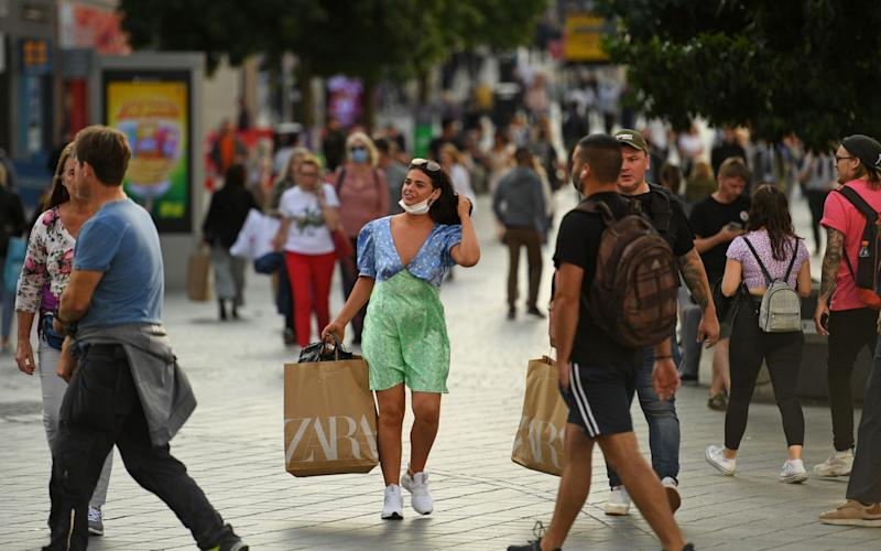 Shops, restaurants and pubs are still open in Liverpool despite a spike in cases - Oli Scarff/AFP