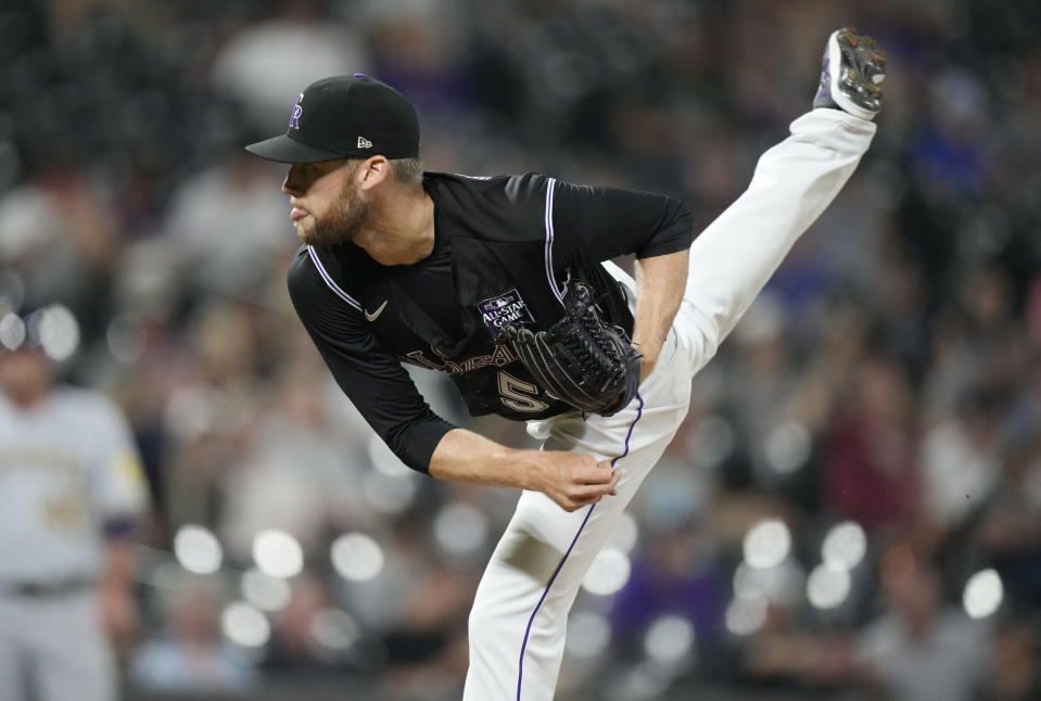 Colorado Rockies relief pitcher Daniel Bard works agtainst the Milwaukee Brewers during the ninth inning of a baseball game Thursday, June 17, 2021, in Denver. The Rockies won 7-3. (AP Photo/David Zalubowski)