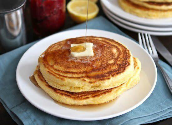 "<strong>Get the <a href=""http://www.twopeasandtheirpod.com/lemon-cornmeal-pancakes/#more-12433"" rel=""nofollow noopener"" target=""_blank"" data-ylk=""slk:Lemon Cornmeal Pancakes recipe"" class=""link rapid-noclick-resp"">Lemon Cornmeal Pancakes recipe</a> from Two Peas and their Pod</strong>"